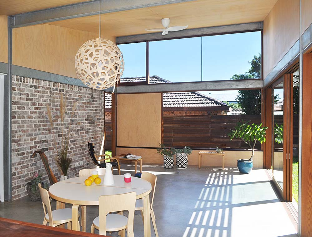 best builders in australia Marrickville home renovation - dining area with brick and wood work - Clockwork Constructions