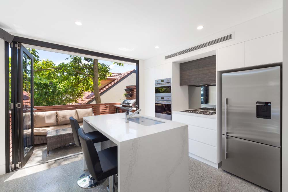 marble kitchen Rose bay Home Renovation - Inside kitchen renovation - White marble with white cabinets and outside view