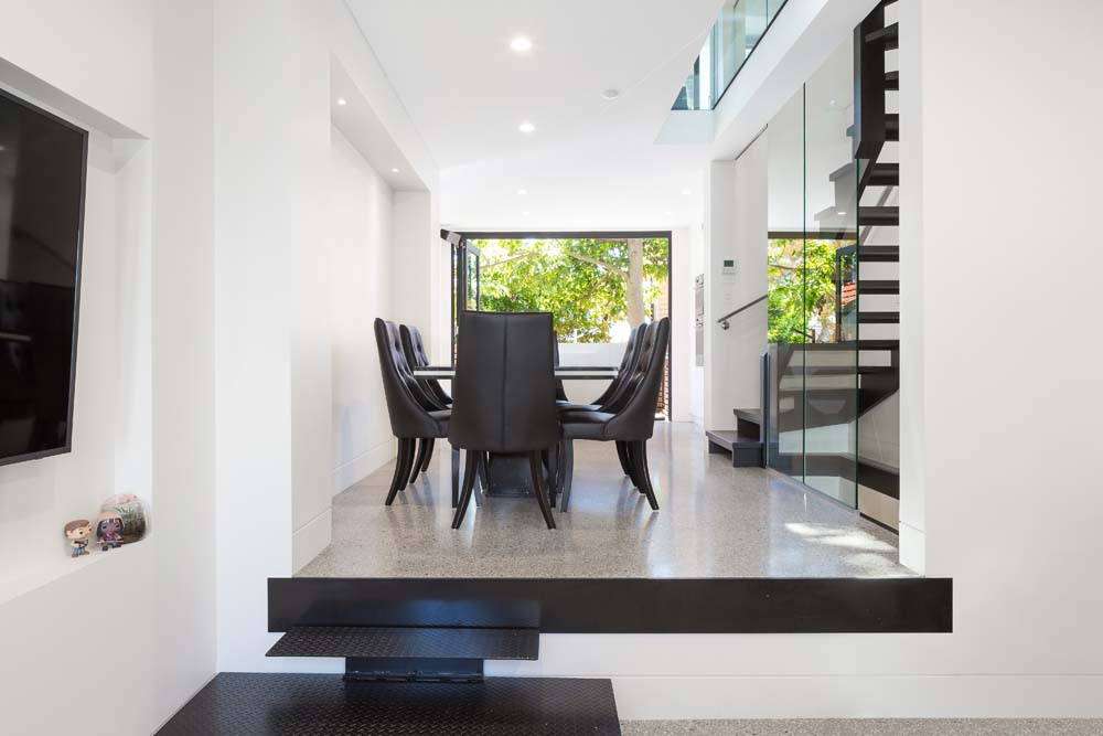 house builders Rose bay Home Renovation - Dining area with outside view and wooden stairway - Home renovation