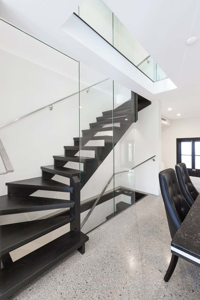 builders near me Rose bay Home - Wooden stairway with glass finishing and marble dining area - Home Renovation