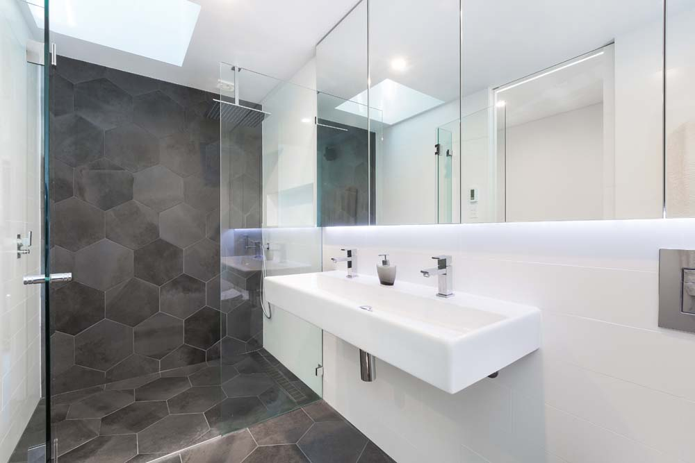 house builders Rose bay Bathroom Renovation - mix of grey hexagon tiles and white bathroom tiles with white bathroom fittings - Home Renovation