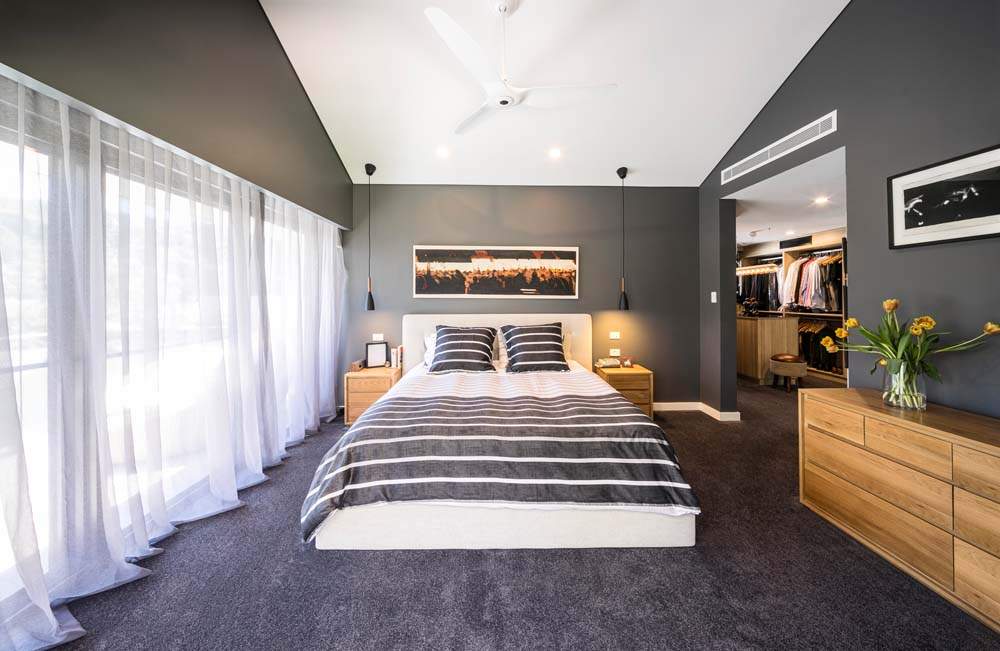 Woronora Home Renovation - Bedroom with dark walls, wooden fittings and white curtain
