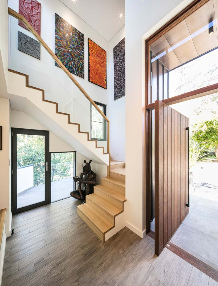 Woronora - Front door with wooden finishing and wooden stairway - Home Renovation