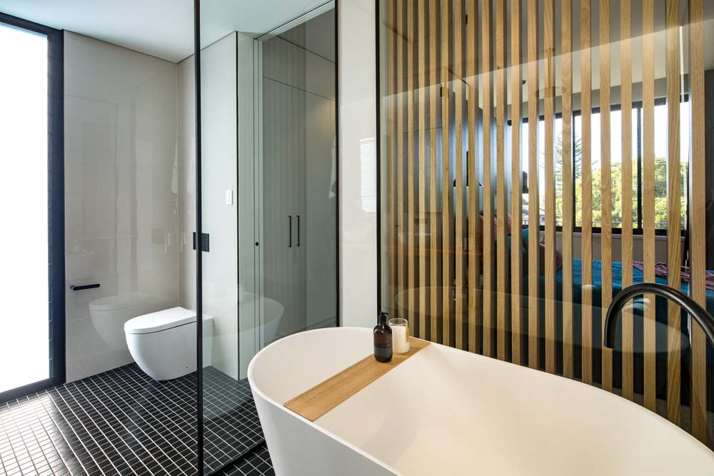 best builders sydney - house builders Cronulla Duplex - home bathroom renovation with woodwork finish and modern fittings - Clockworks Constructions