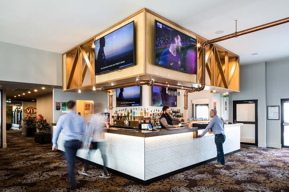 Kings park tavern - Bar area with wood work and carpeting 3