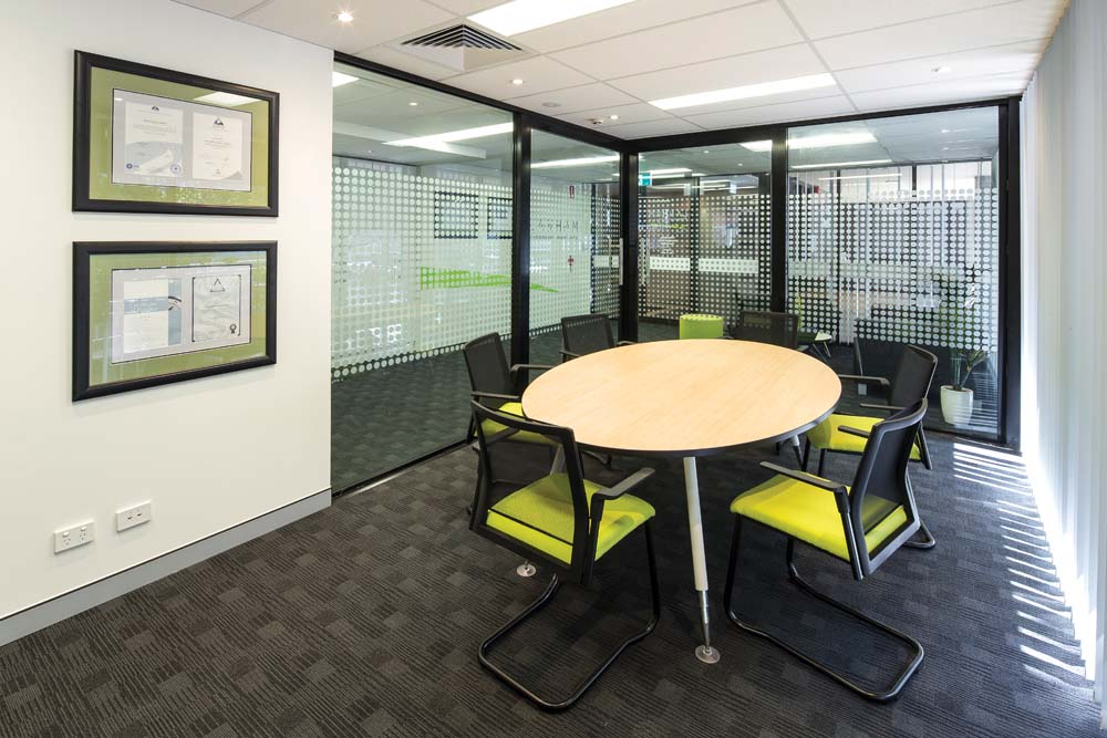Lanham Financial Advisory - Commercial Renovation -dining area white walls and black carpet