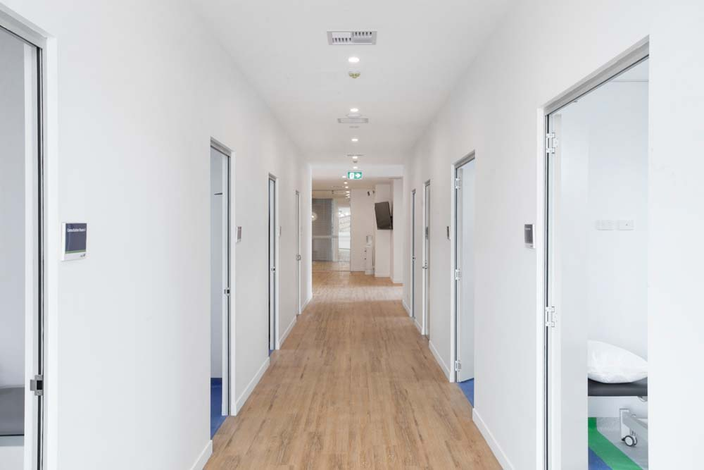 Kirrawee Medical Centre - Healthcare Renovation - Hospital corridor with wood work finish
