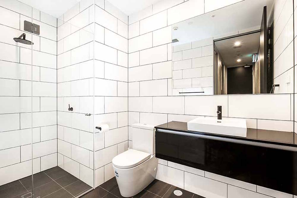Modern bathroom renovation - real estate company - commercial renovation