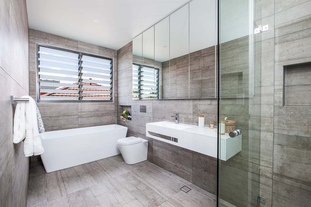 Castelnau Home Renovation Bathroom with wooden finish - Clockwork Constructions