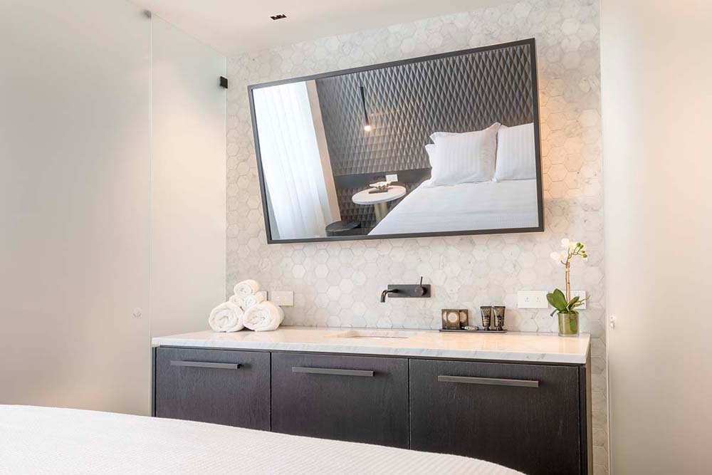Castlereagh boutique hotel - Hospitality renovation - bedroom renovation with marble and contrasting wood work