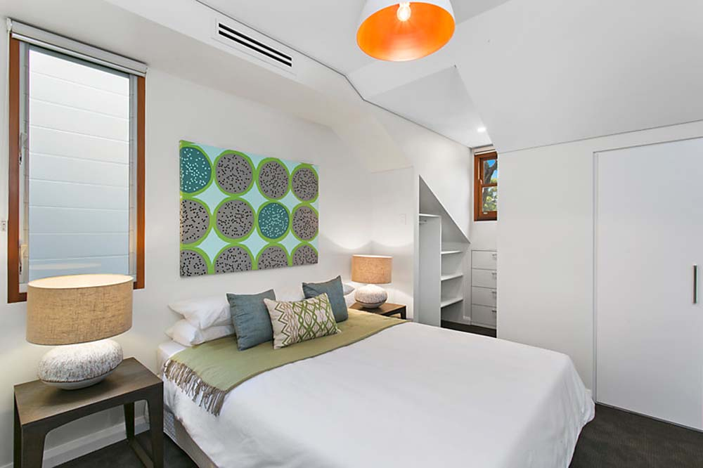 Zetland Bedroom renovation 2 with white coloured theme and contemporary artwork and modern furnishing - Home Renovation